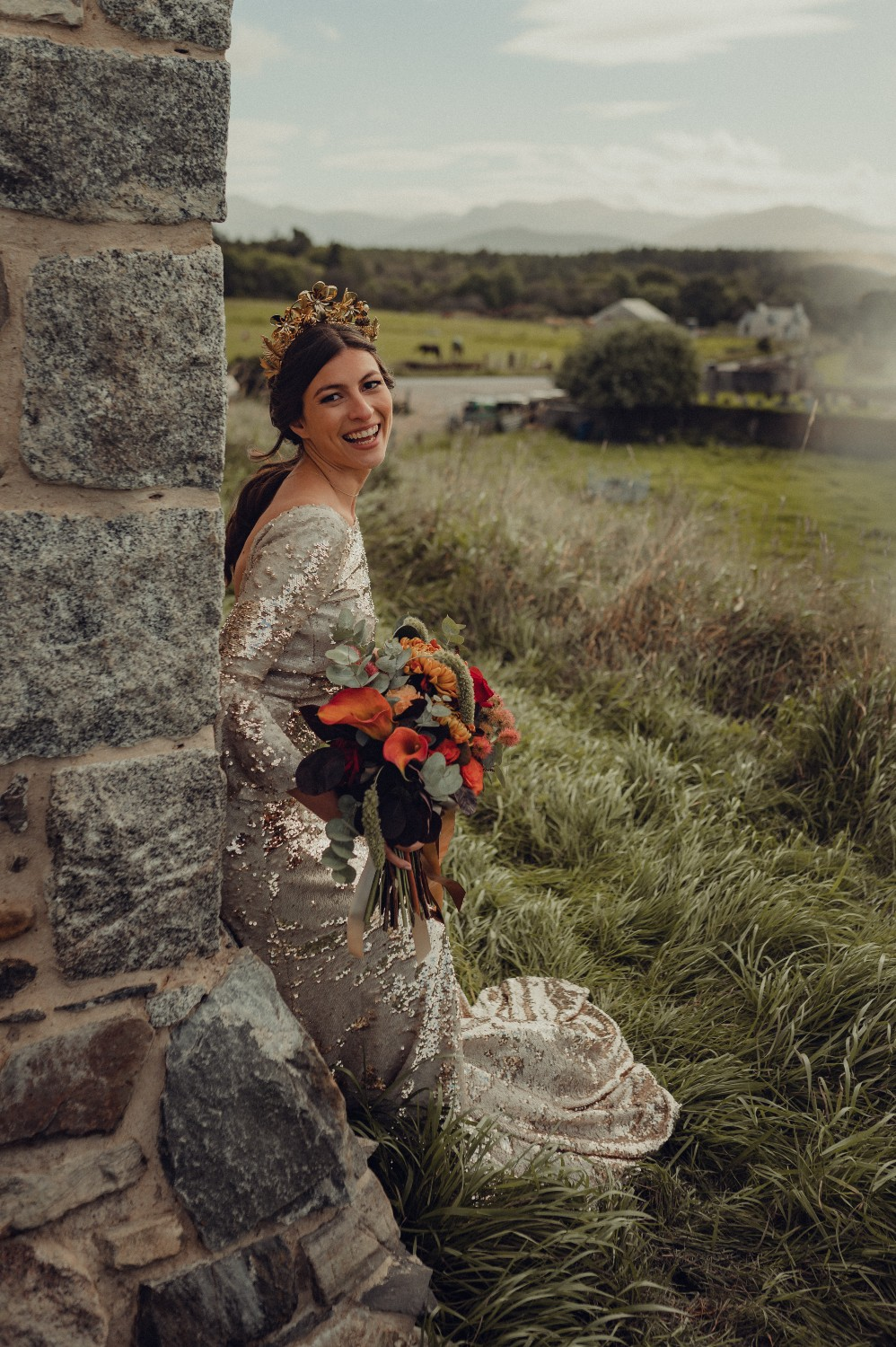 The bride leans against the wall at Castle Roy, Nethy Bridge.