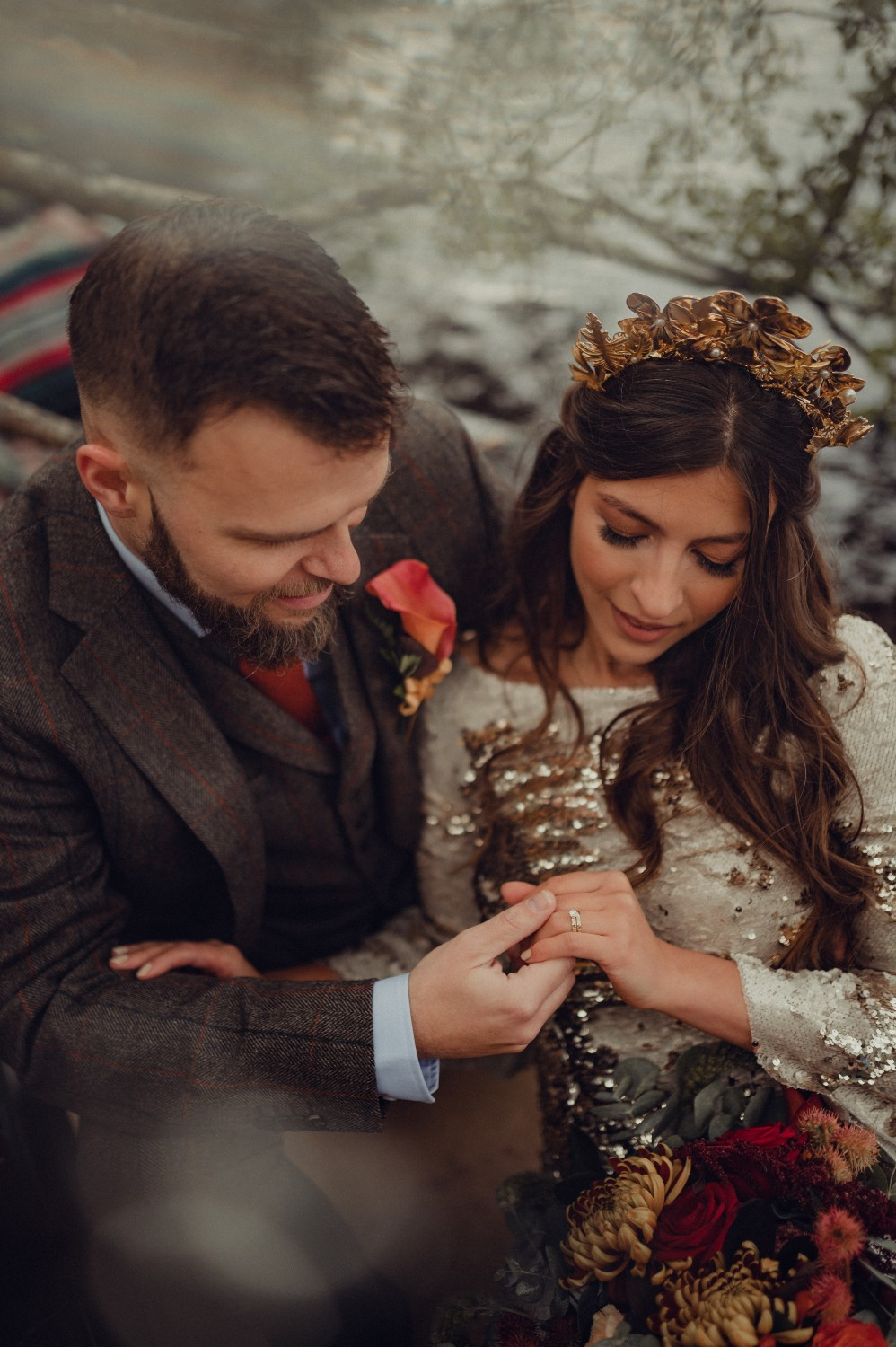 The married couple admire her new wedding ring in the Highlands of Scotland