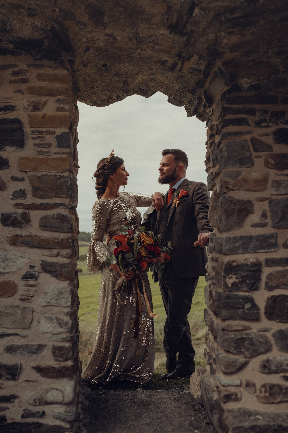 Newlyweds take a moment to themselves at Castle Roy in Nethy Bridge, Highlands.