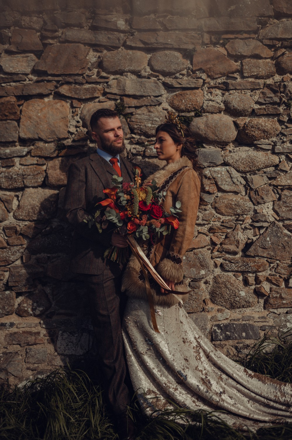 The couple enjoying a quiet moment at their autumn wedding in the Highlands of Scotland