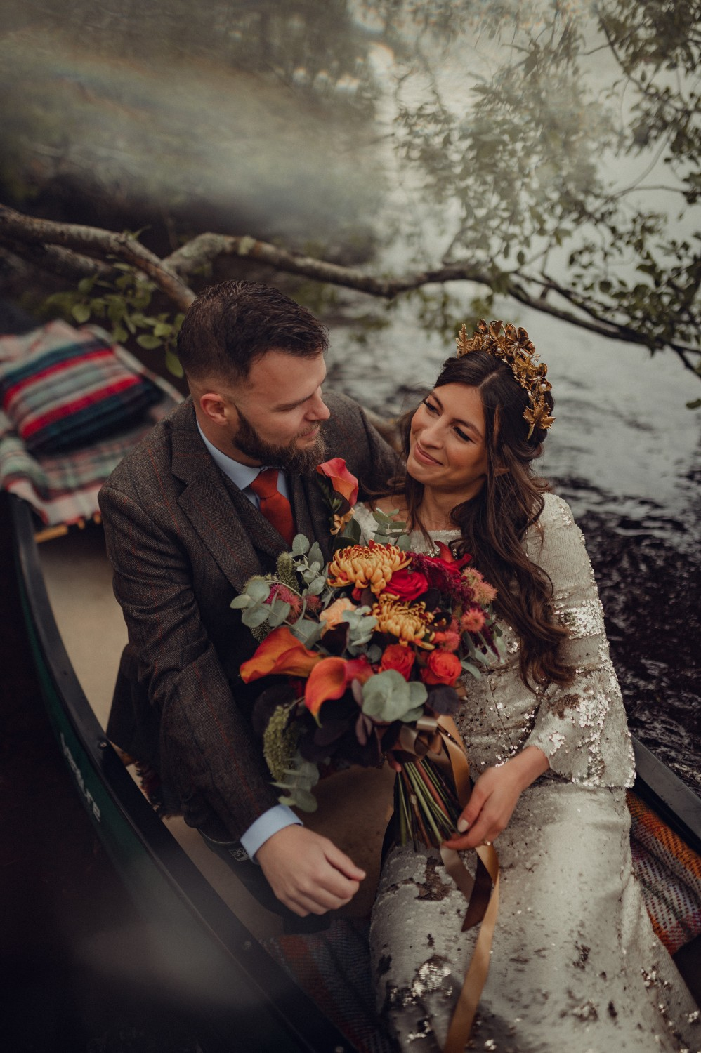 The couple enjoy a boat ride on a loch in the Cairngorms National Park