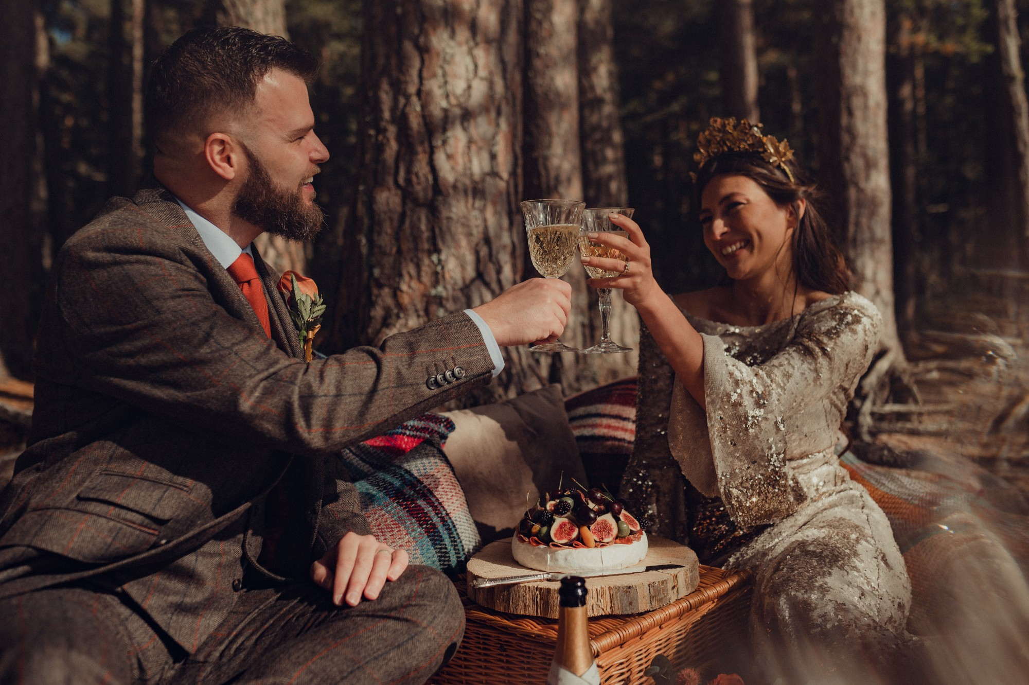 Bride and groom toast each other at their Highland wedding picnic