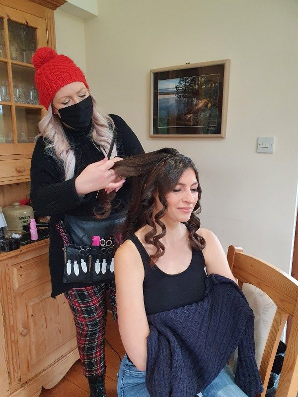 The hairdresser gets to work at the start of the day.